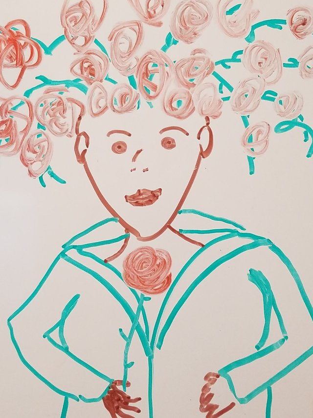 A whiteboard drawing of a woman with vines and roses for hair